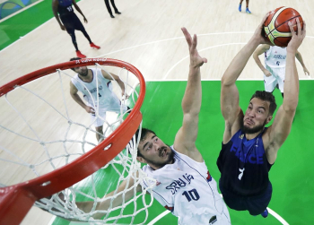 Nikola Kalinic (left, white jersey) and Joffrey Lauvergne (France) during their basketball match