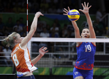 Judith Pietersen (left) of Netherlands spikes as Tijana Boskovic of Serbia blocks during their volleyball game