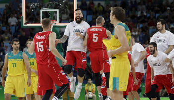 Serbia's players celebrate after winning the semifinal basketball match against Australia