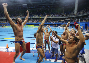 Players of Serbia's water polo team celebrates winning gold medal